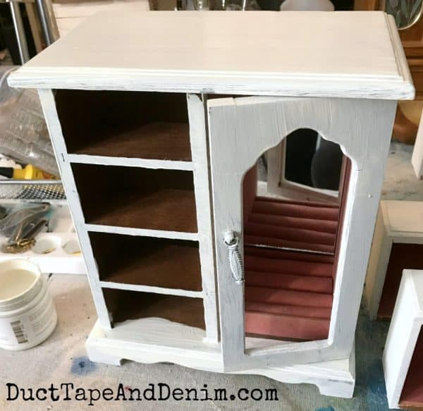 After one coat of paint, jewelry cabinet makeover on DuctTapeAndDenim.com