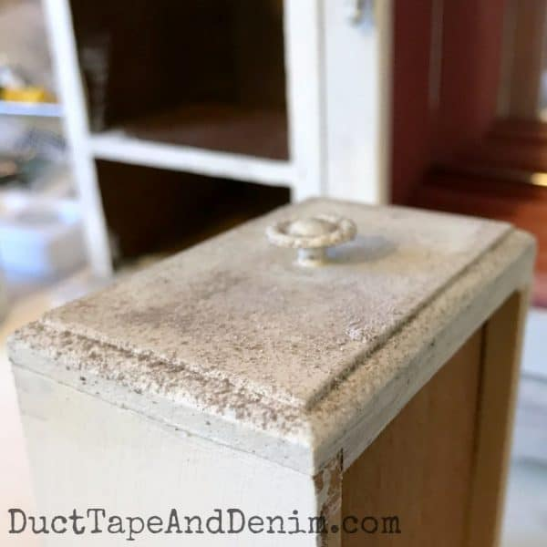 Antiquing dust on my painted jewelry cabinet makevoer on DuctTapeAndDenim.com
