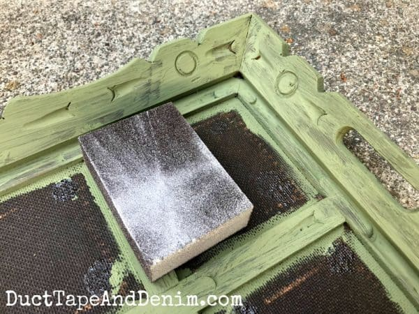 Sanding painted thrift store tray | DuctTapeAndDenim.com