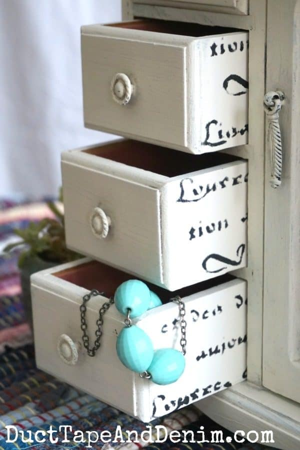 Stenciled drawers in Country Chic Paint Vanilla Frosting jewelry cabinet makeover | DuctTapeAndDenim.com