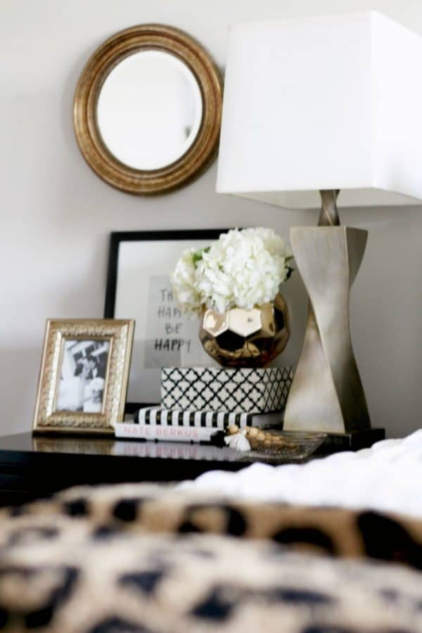 How to style a nightstand, bedside table with lamp, books, and art
