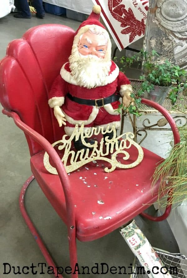 Evil Santa on vintage red chair at flea market | DuctTapeAndDenim.com