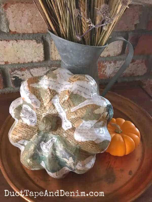 Decoupaged paper mache pumpkin fall vignette