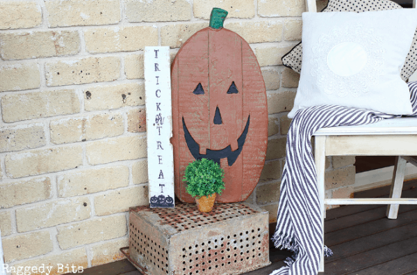 trick or treat and jack o lantern signs on porch