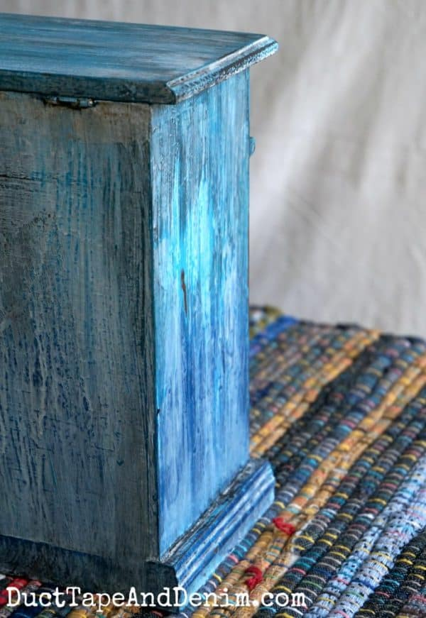 left side of painted turquoise drip jewelry cabinet