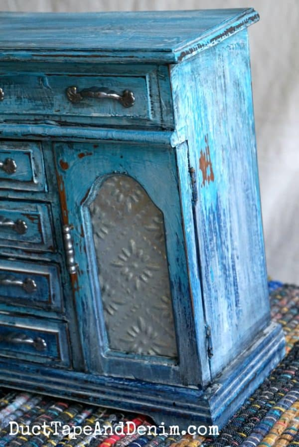 side of painted jewelry cabinet, turquoise drip