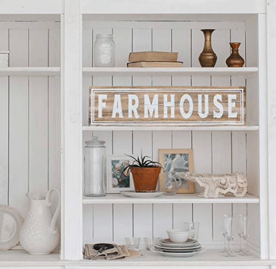 farmhouse sign with white words on shelf