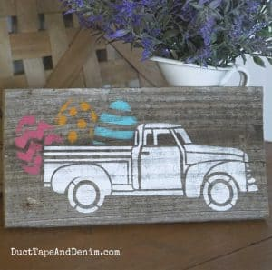 Easter truck sign on old fence board