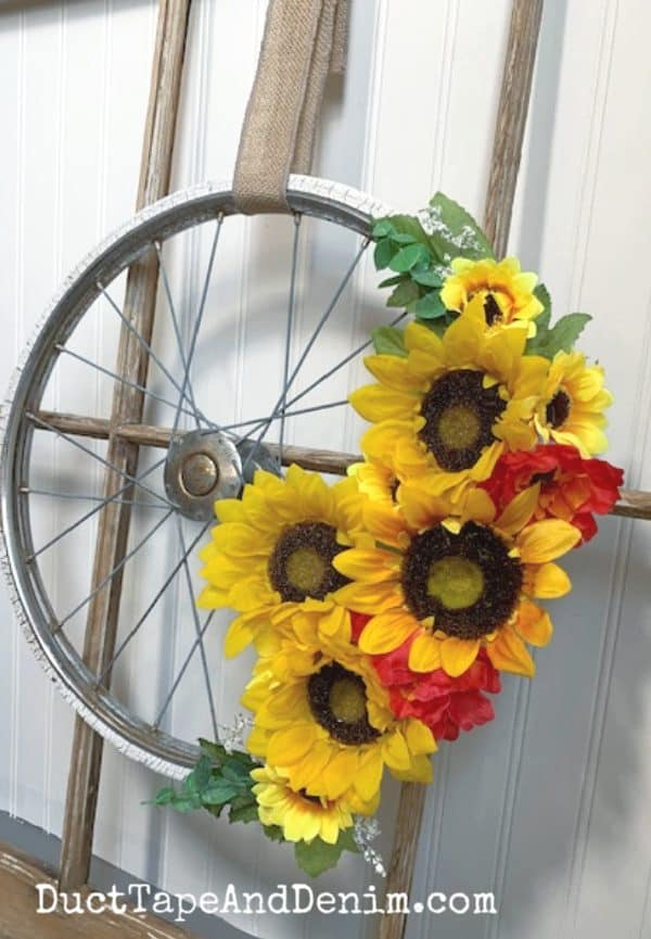 bicycle wheel wreath on old window