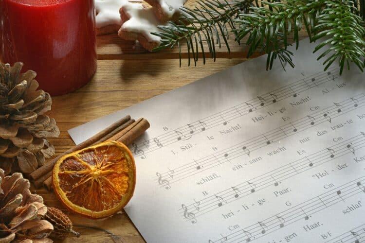 Christmas sheet music and candle