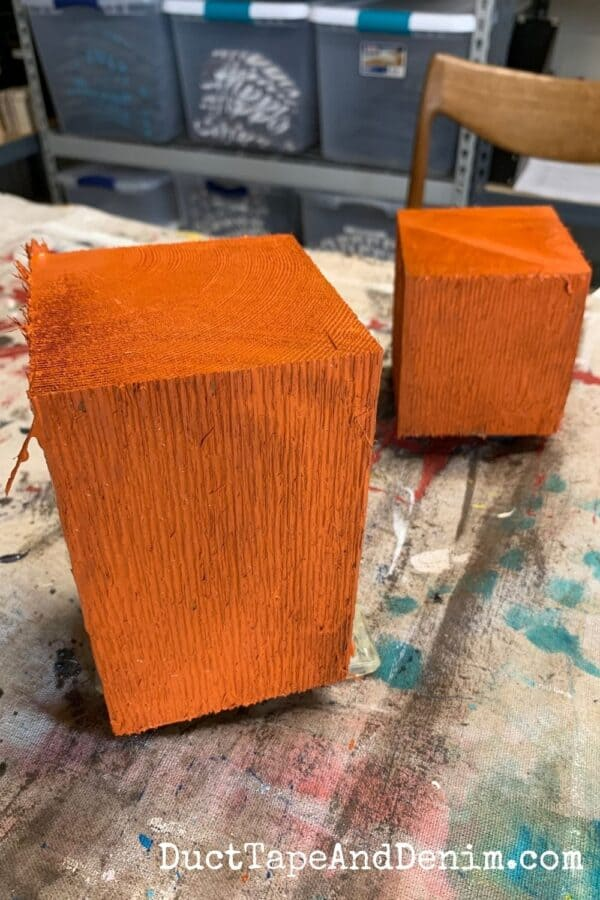 4 x 4 scrap wood pieces painted orange