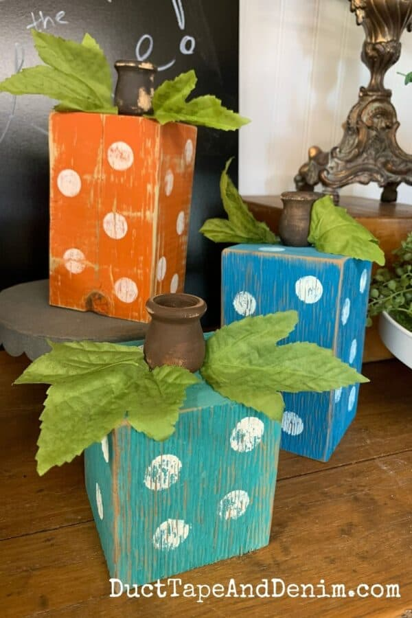 set of three wooden pumpkin candle holders with polka dots