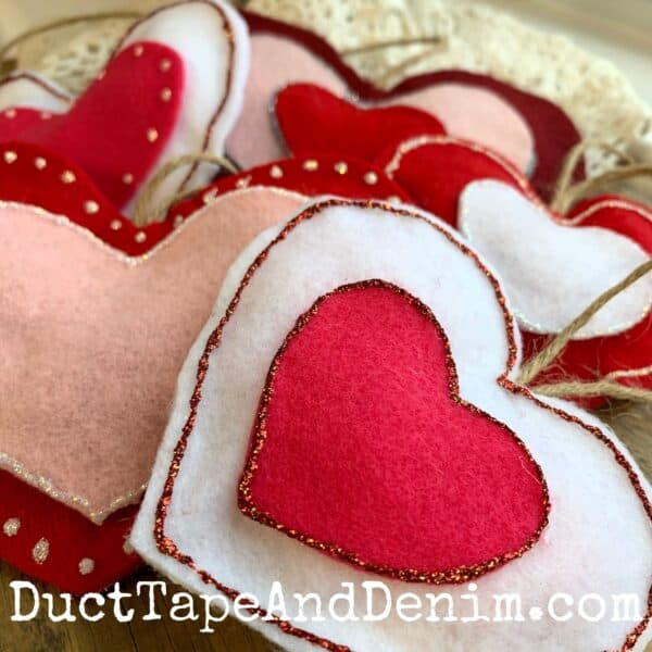 completed felt heart ornaments for valentine or christmas tree